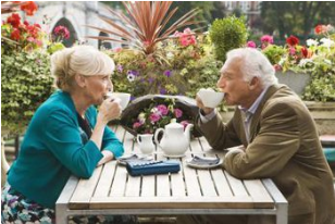 two older adults drinking tea