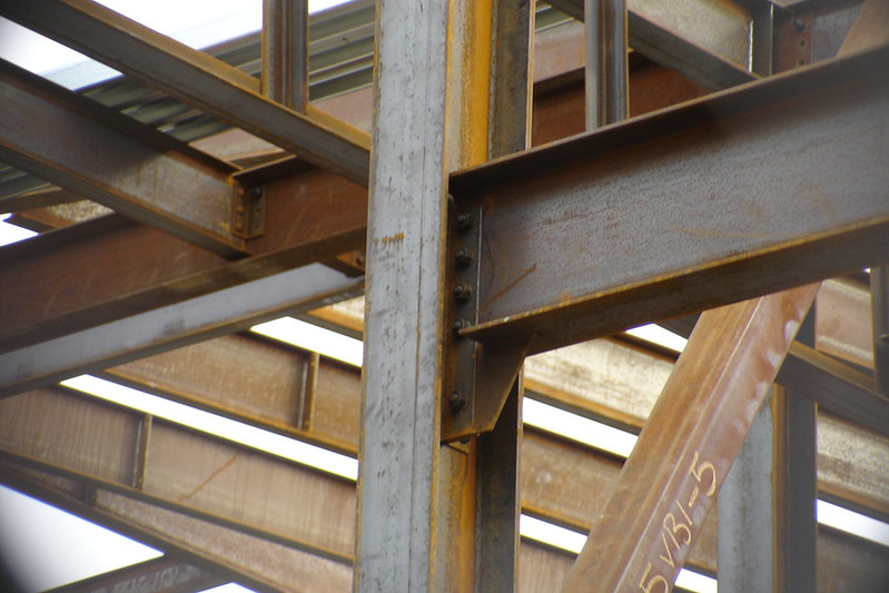 building under construction with steel girders exposed