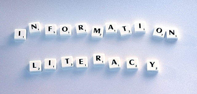 information literacy spelled out using Scrabble tiles