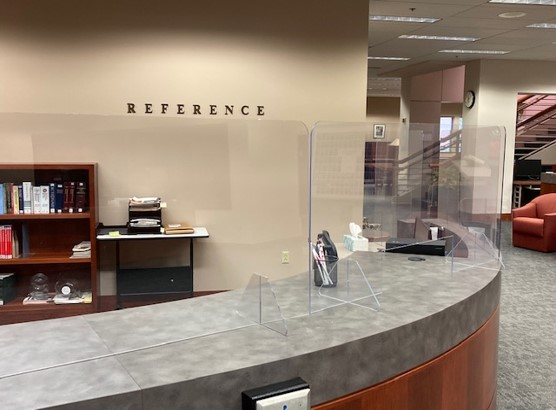 Reference desk with plexiglass shielf