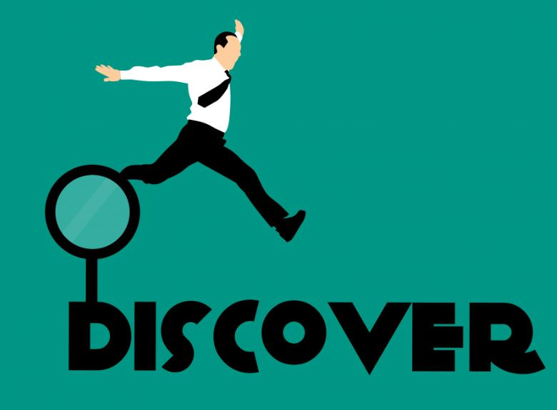 man leaping off magnifying glass onto word discover