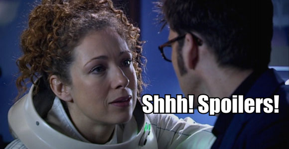 Woman in a space suit saying Shhh...Spoilers to a man