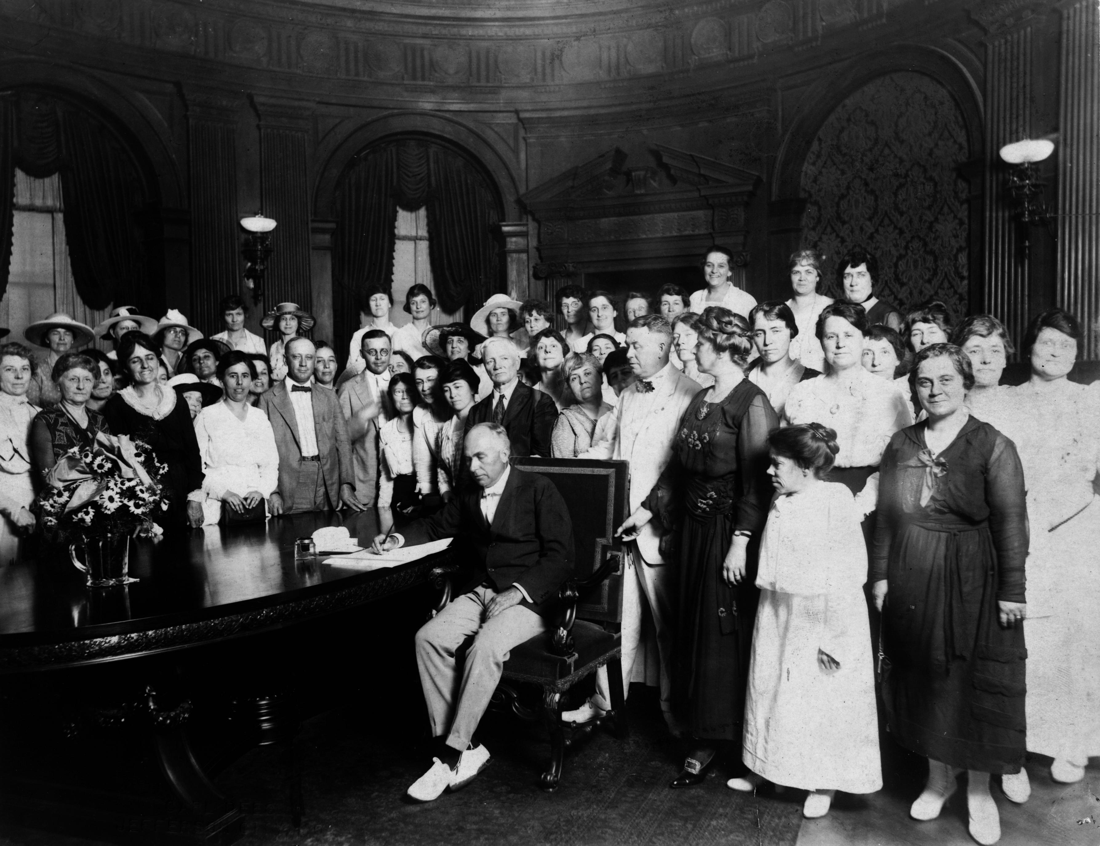 Gov. Gardner signing resolution ratifying the 19th amendment