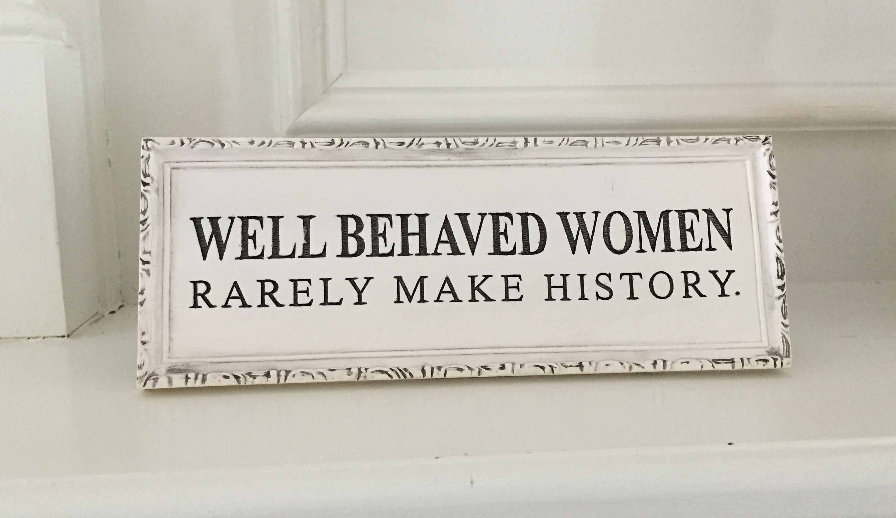 desk plat with text: Well Behaved Women Rarely Make History