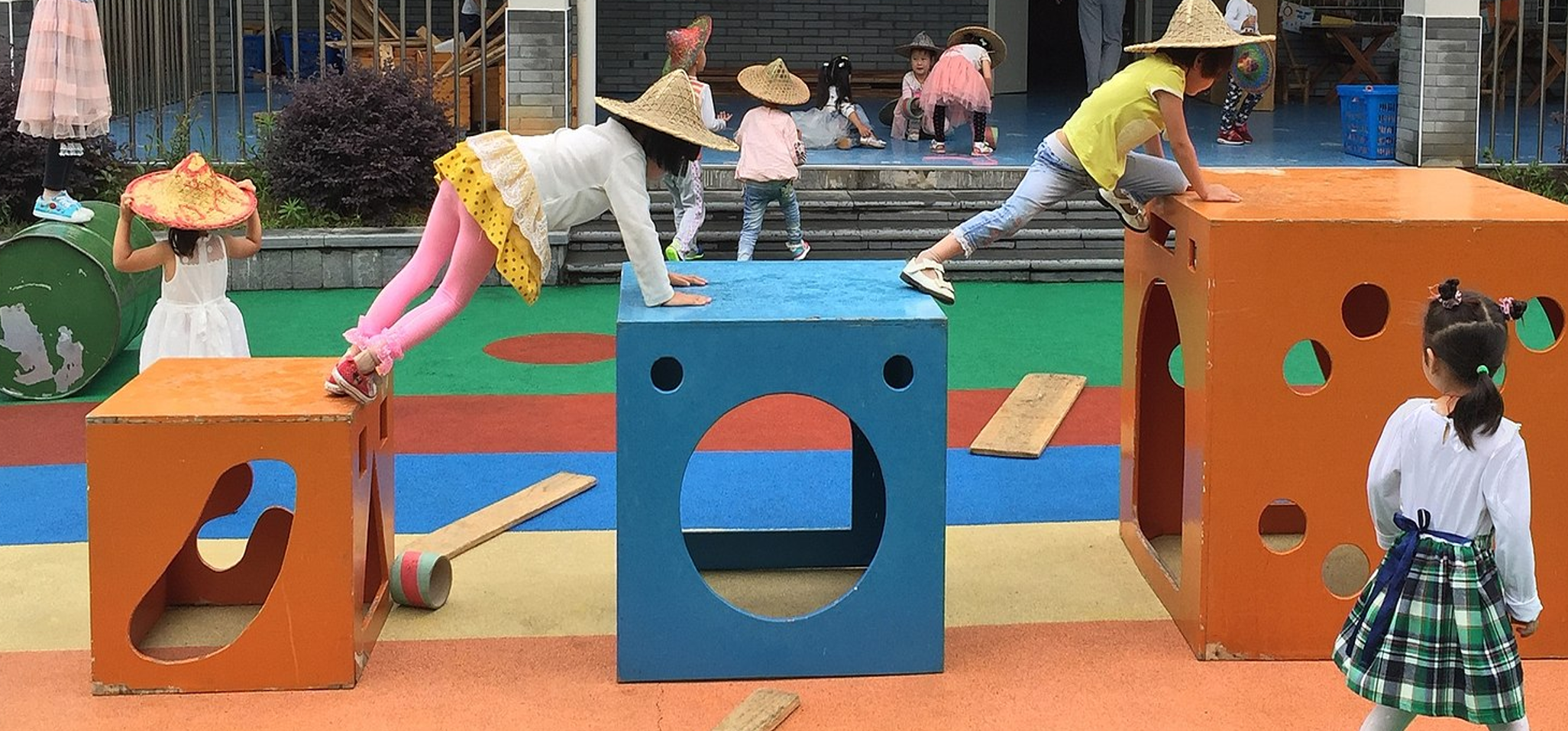 Children in Anji, China interacting with Anji Play's Climbing Cubes