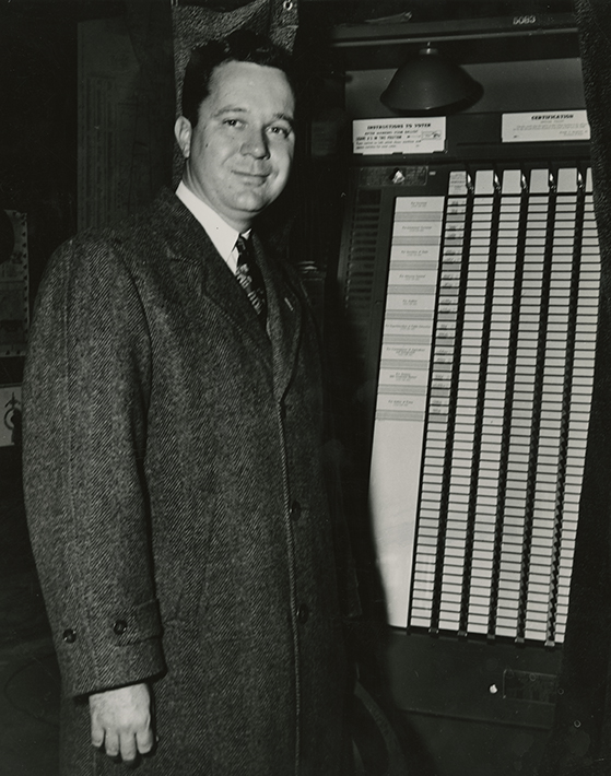 Photograph of Russell B. Long in voting booth, n.d.