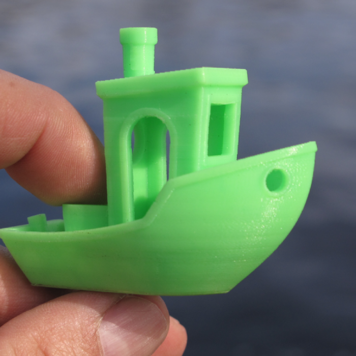 Image of a green 3D printed boat in PLA material