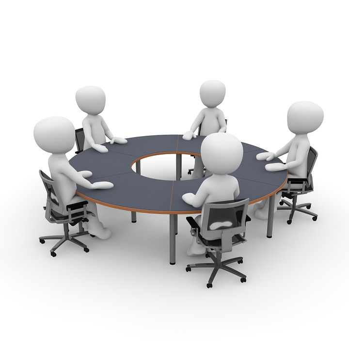 Cartoon figures sitting around a round table