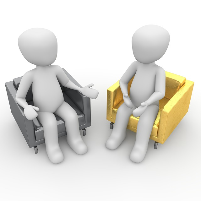 Two cartoon figures sitting separately in a gray chair and a yellow chair