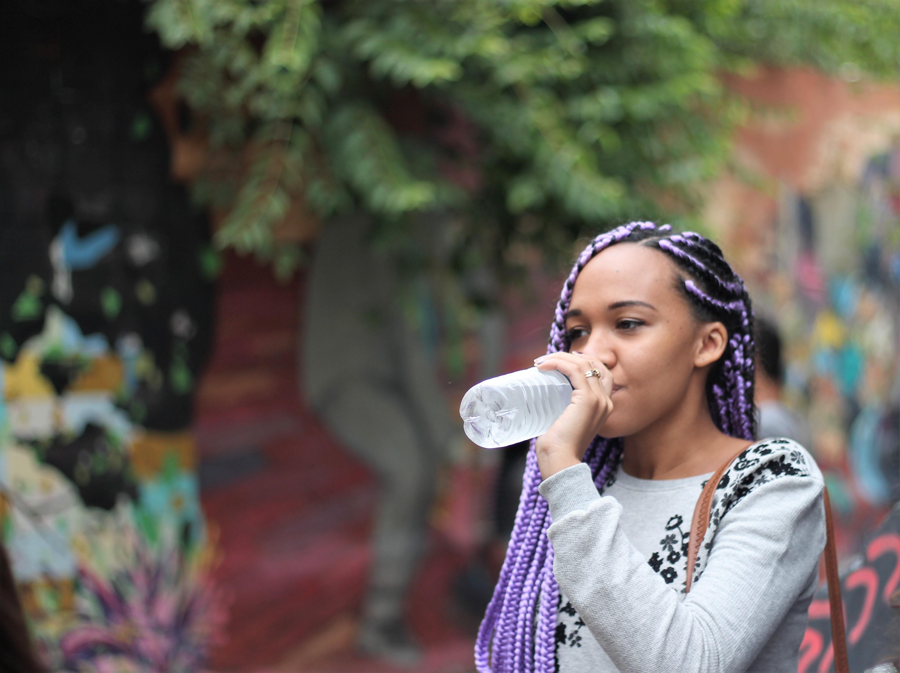 POC woman drinking water