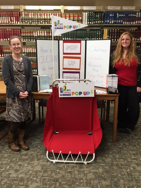 librarians and a pop up display