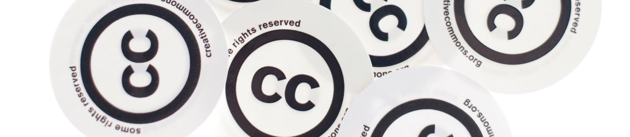 Round Creative Commons license stickers in random pattern