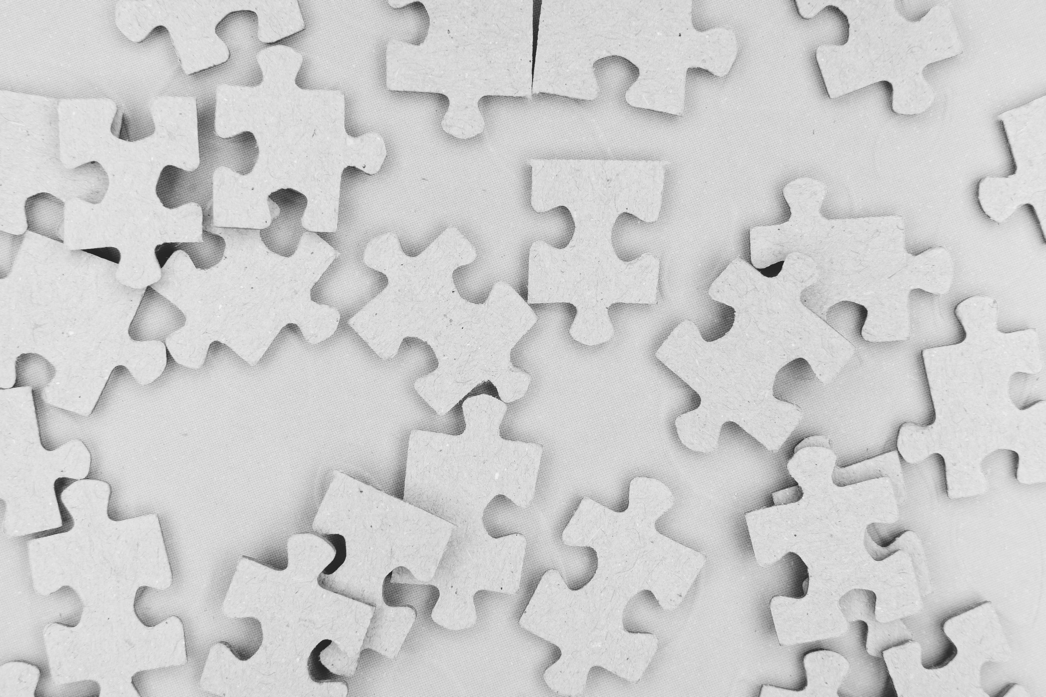 A series of blank puzzle pieces against a plain background