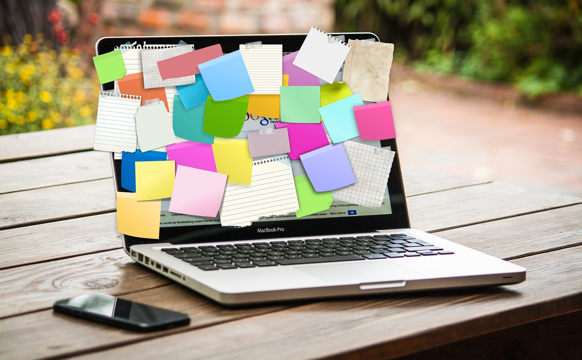 Laptop computer covered in post it notes. Image by Gerd Altmann from Pixabay