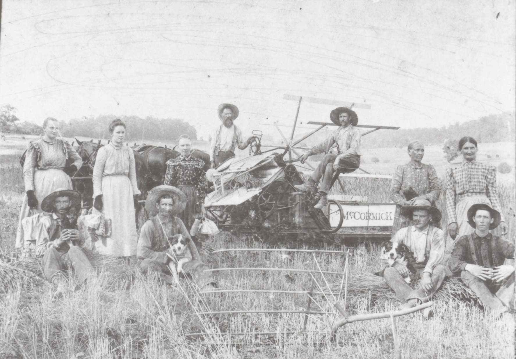 Farm family in field with a McCormick binder in Washington County, Tennessee