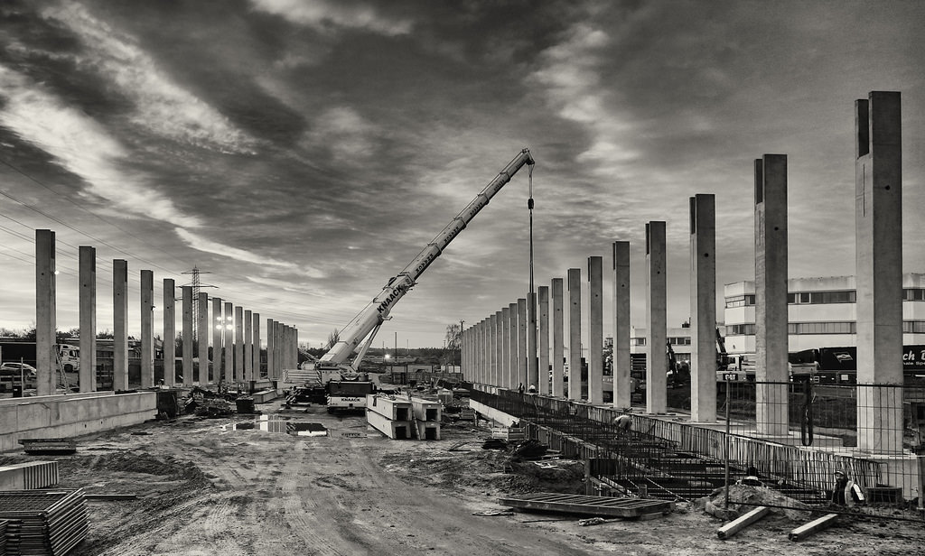 Scene of large scale construction project in black and white