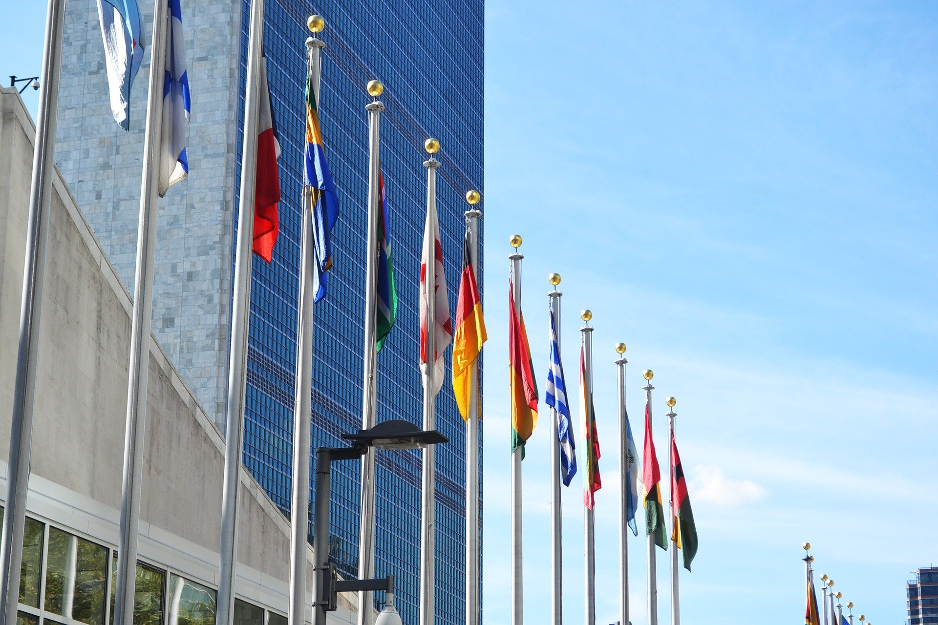 Photograph of international flags in front of UN Building
