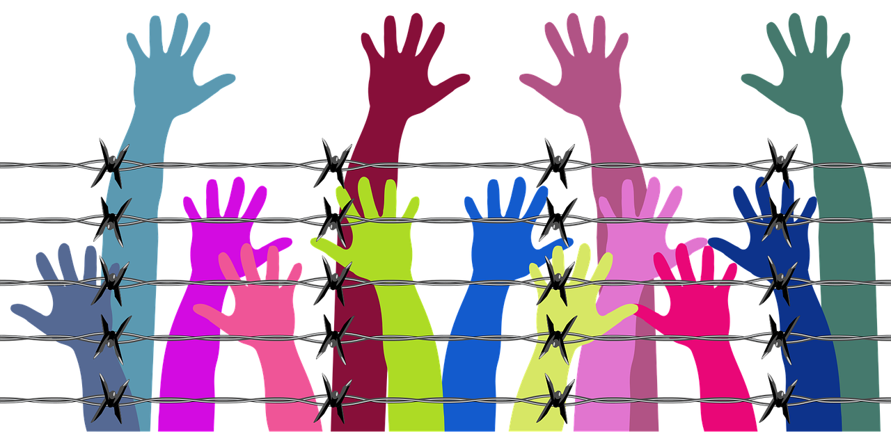 Drawing of hand of different colors with barbed wire