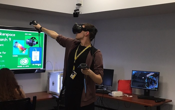 student playing VR game