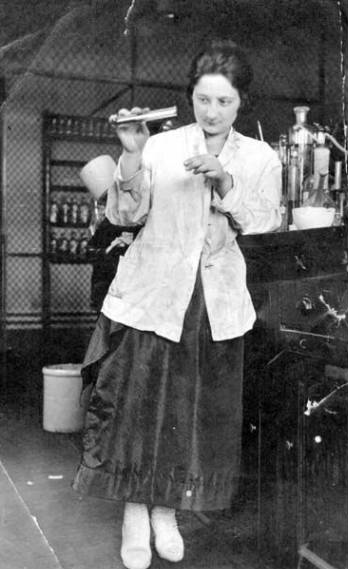 Bella Kracower Secord working with test tube in University of Washington chemistry lab, circa 1919-1920
