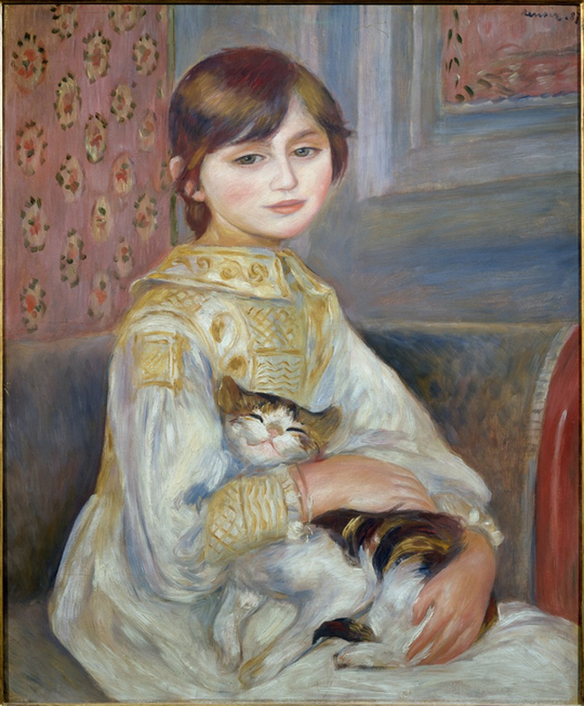 Portrait of seated young girl holding a contented-looking cat.