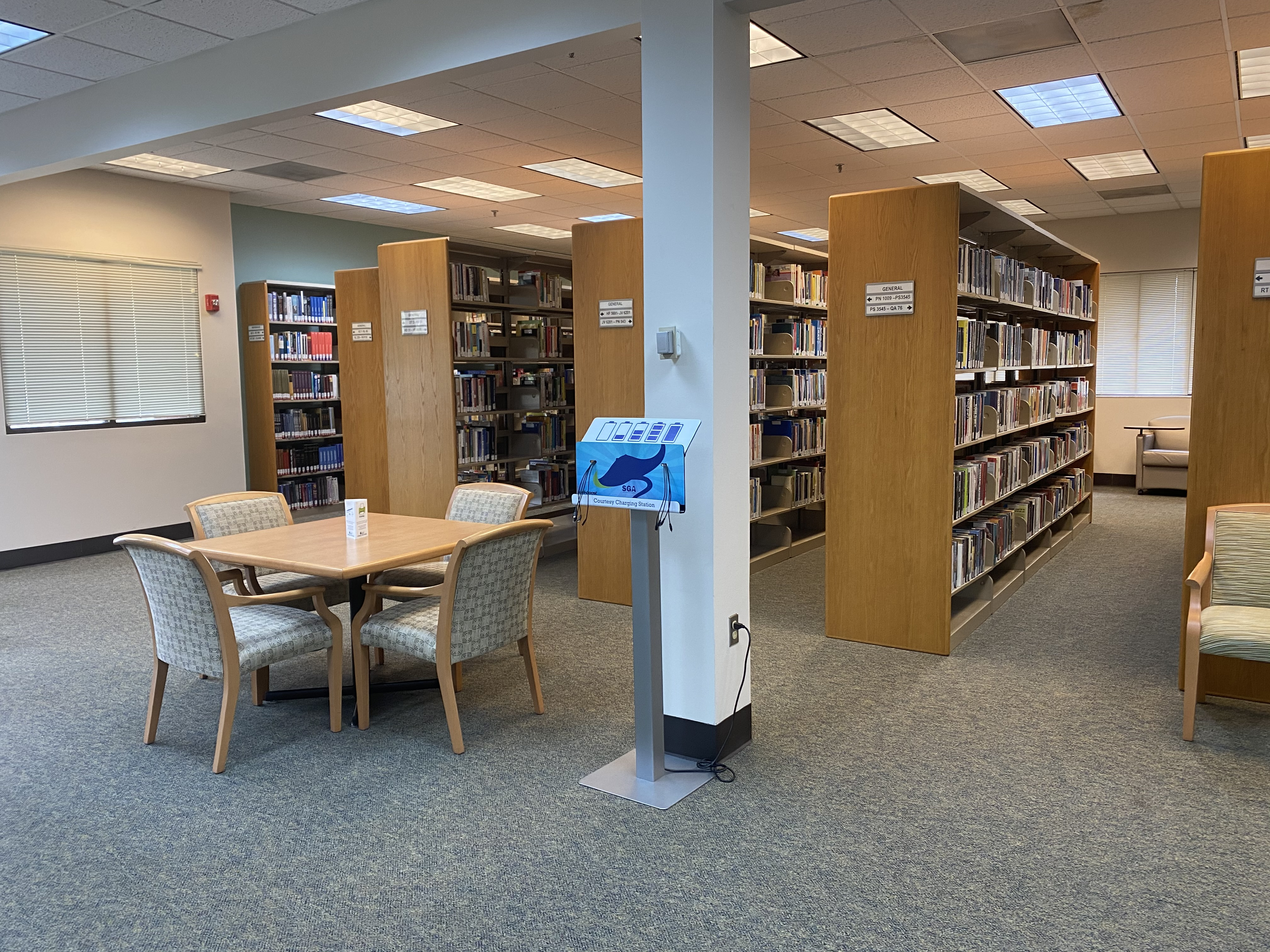 Jesup Library Book Stacks with smart device charging station