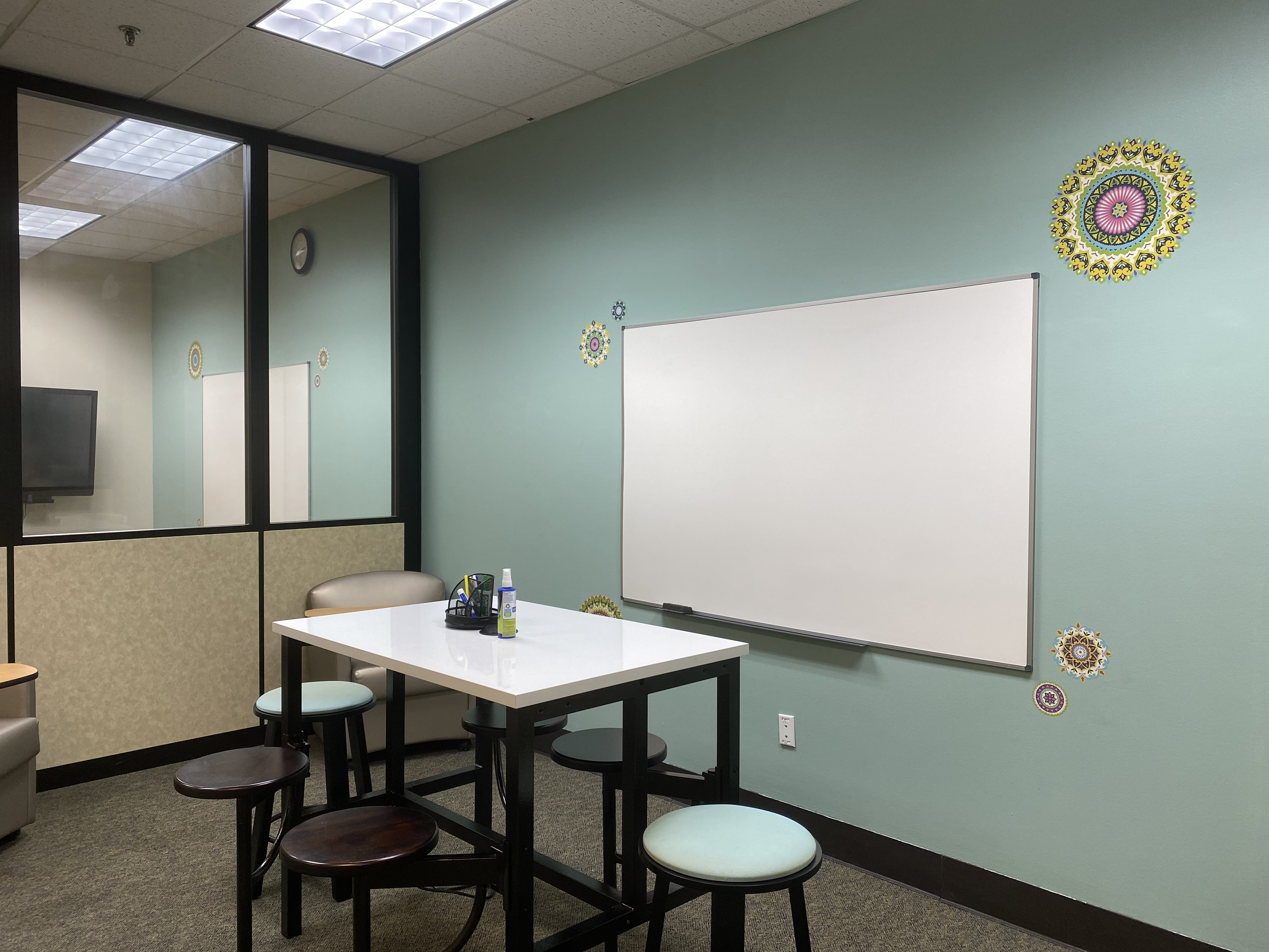 Jesup Library Study Room 1 with white board on the wall and a white board table.