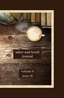 The cover of v. 2, iss. 3 of Saber and Scroll journal features a mug, a globe, and some books on a wooden desk.