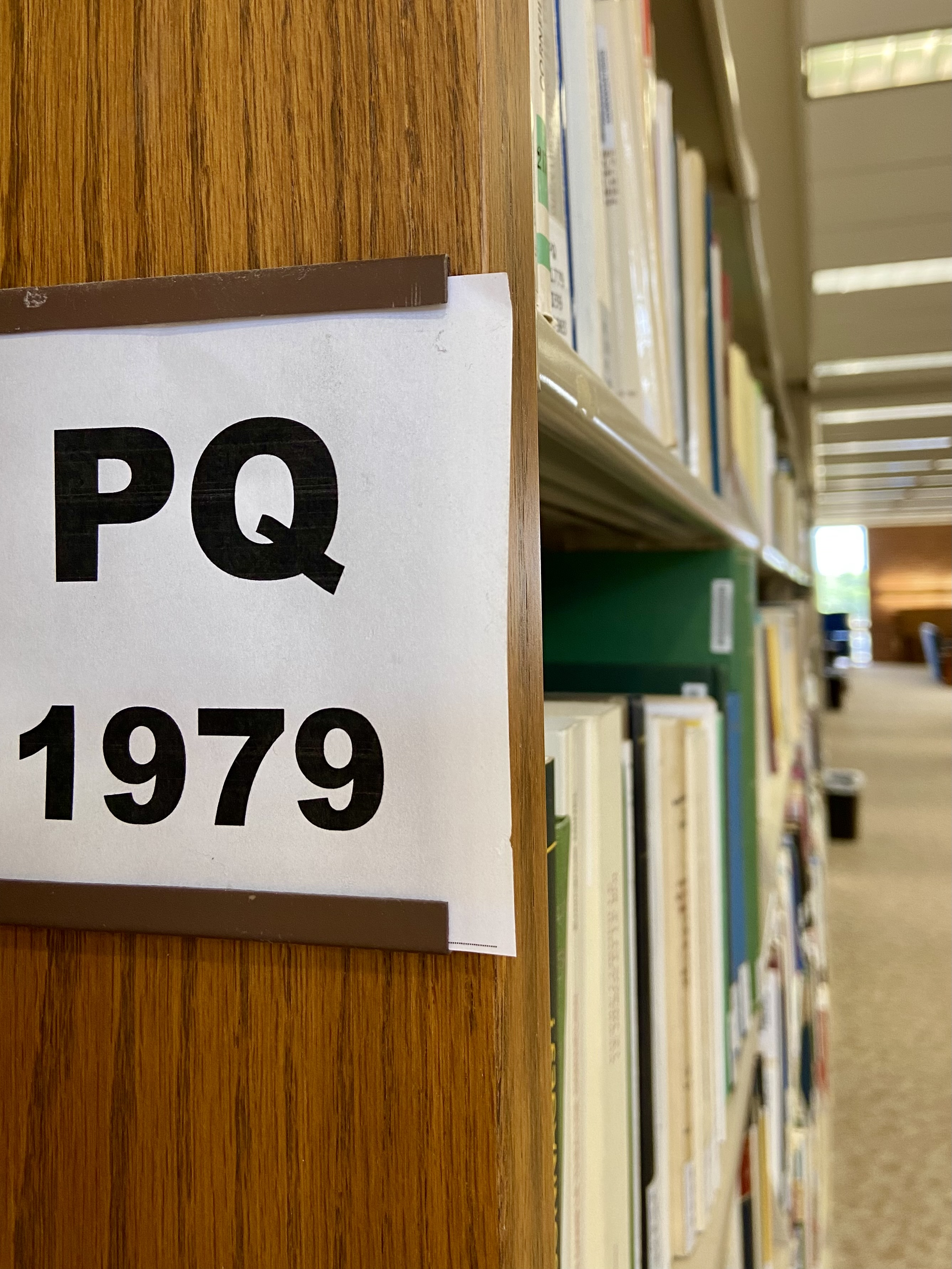 picture of PQ call number sign on bookshelf