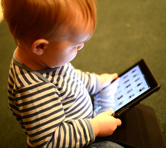Toddler playing with iPad.
