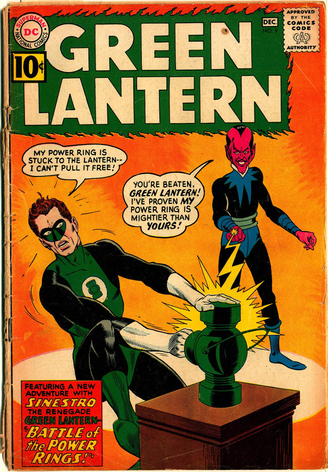 A 1961 issue of The Green Lantern shows the superhero struggling to pull his power ring away from a trap.