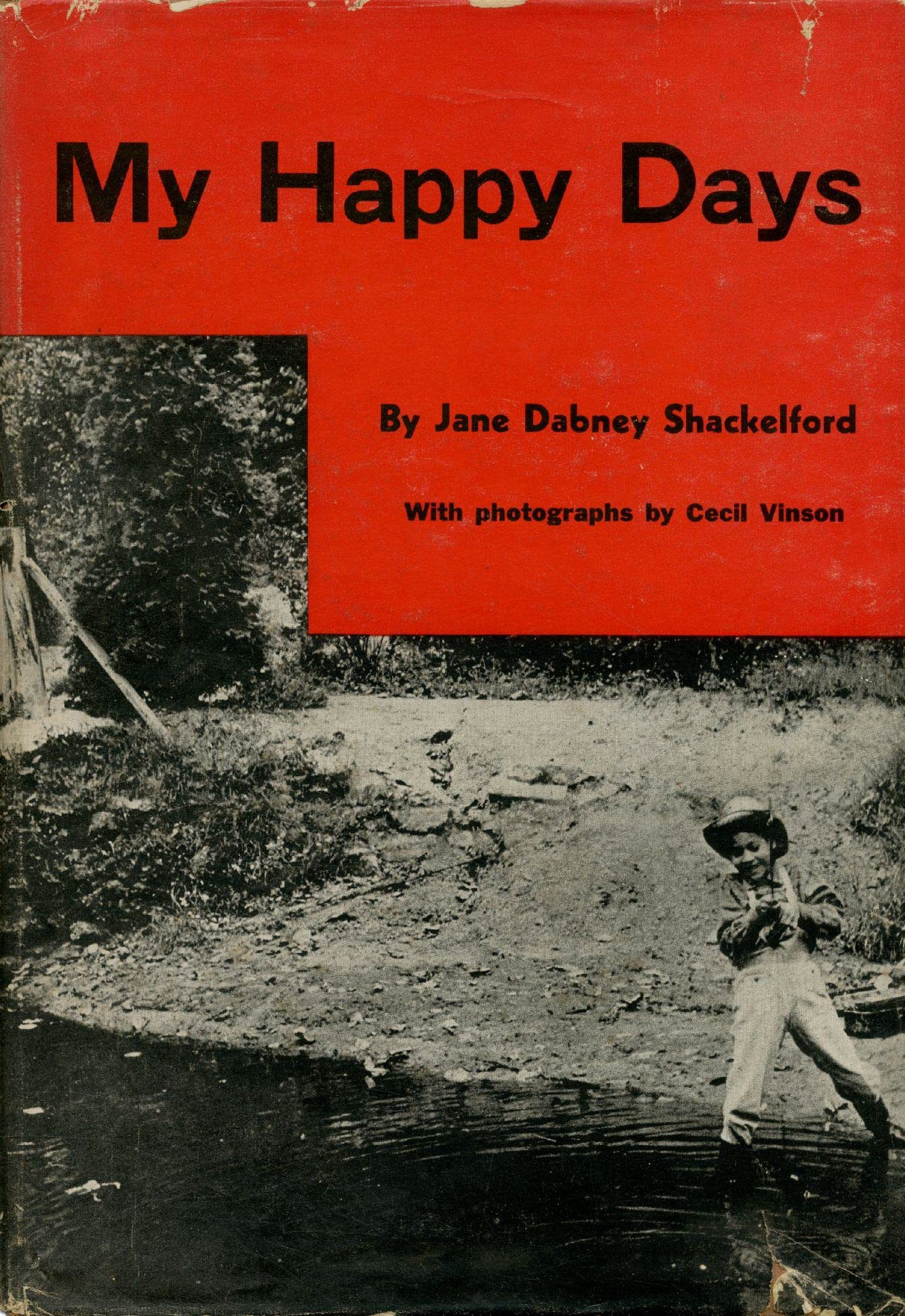 The cover of My Happy Days includes a black & white photo of a young boy fishing in a creek.