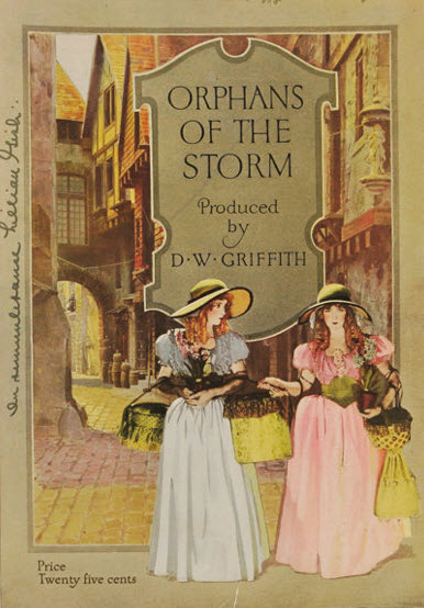 1921 movie program for Orphans of the Storm shows two young women in an 1870s Paris street.