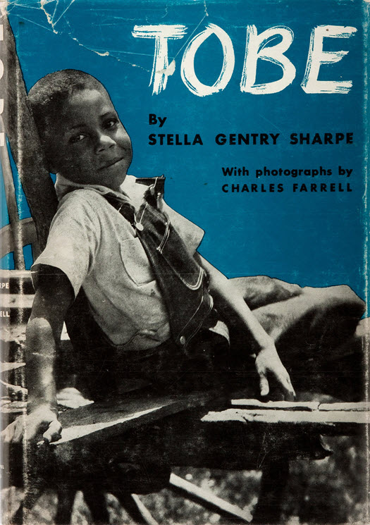 The cover of Tobe, a 1939 photograph book about a six-year-old Black boy and his family, has a photo of Tobe.