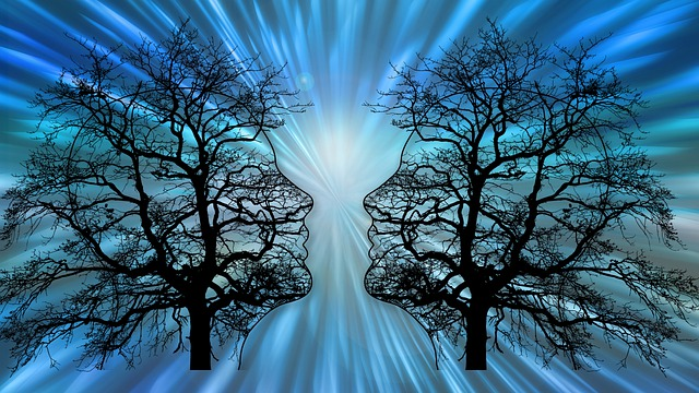 Artistic Image of 2 Black Trees in front of drawn images of a male and female head.  Shades of blue and turquoise..