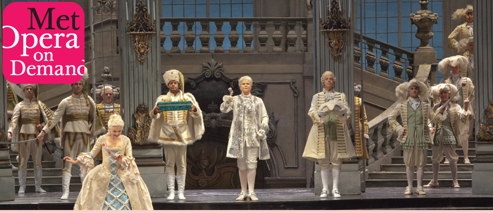 Actors performing on stage with the Met Opera on Demand logo superimposed.