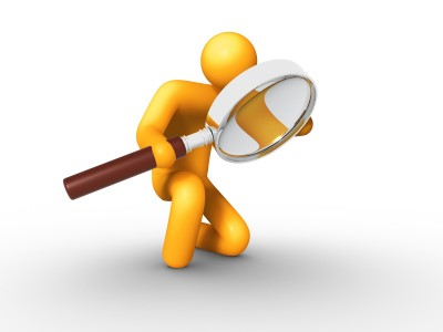 Researcher with magnifying glass