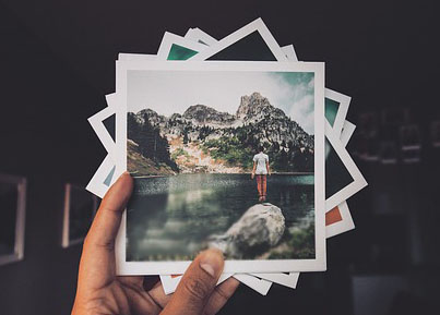 Photo of a hand holding photos