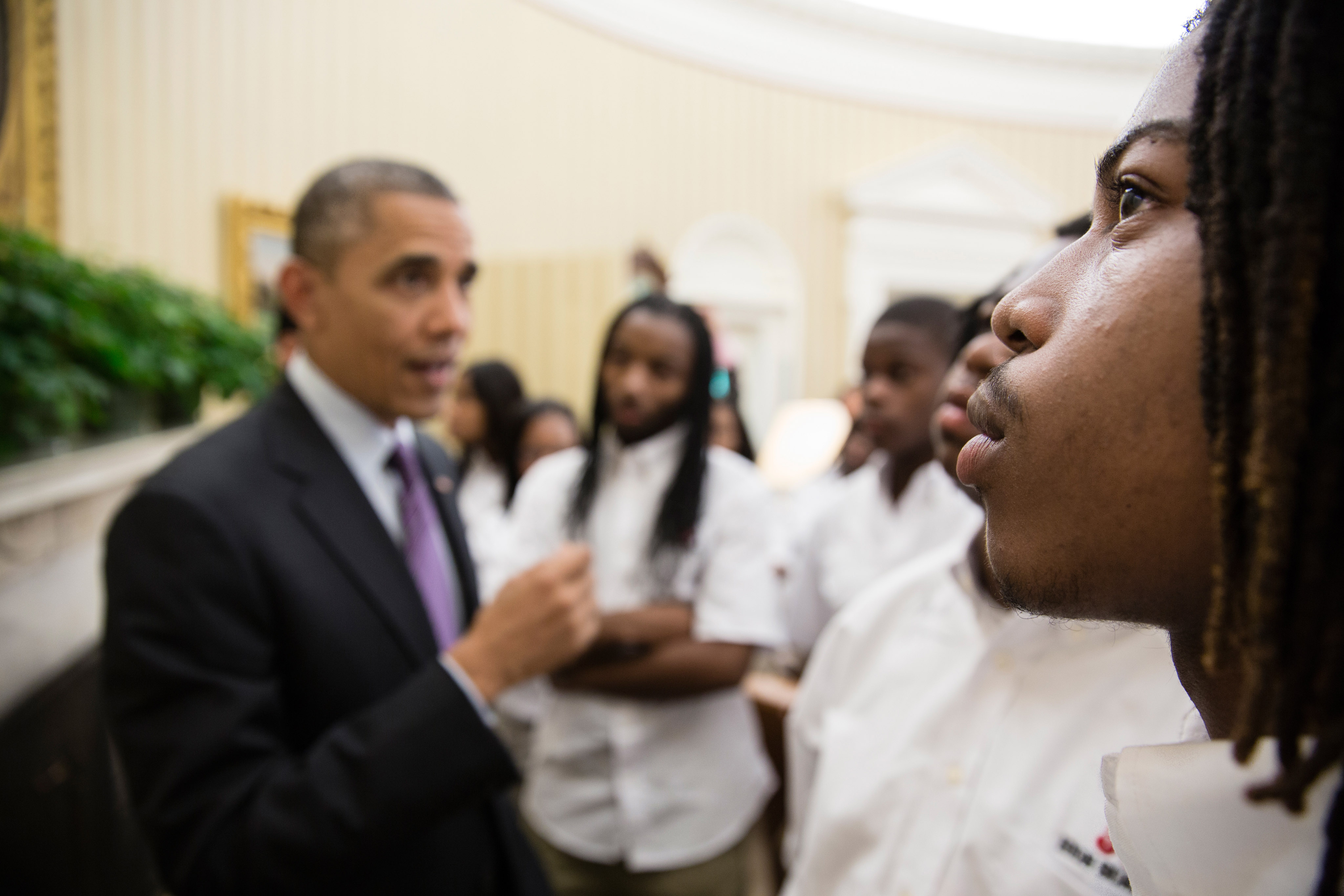 young black male with former president Obama