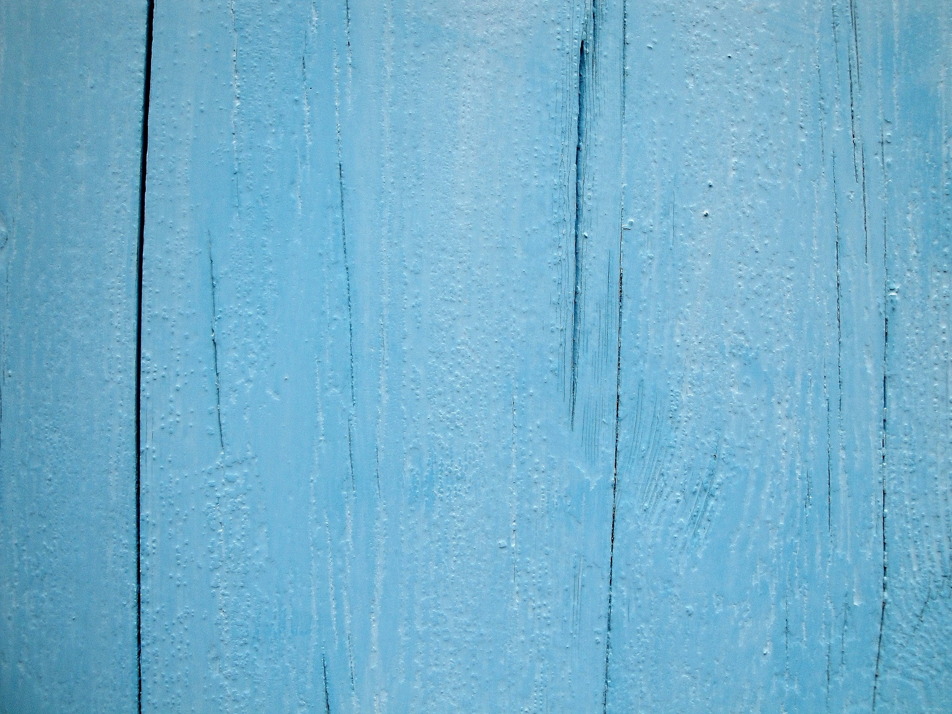 a close up of wood painted blue