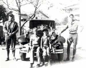 1932 Photograph of Dr. Pat. I. Nixon with sons Robert Nixon (standing) and twins Ben and Thomas Nixon. Courtesy of Leon Valley Public Library and Grace Nixon