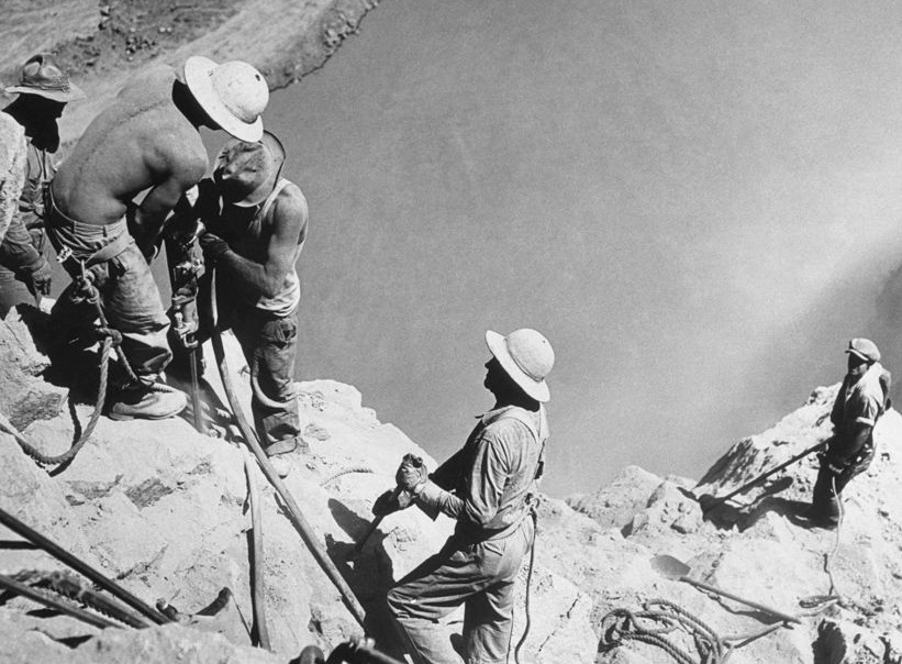 Black and white image of men building the hoover dam