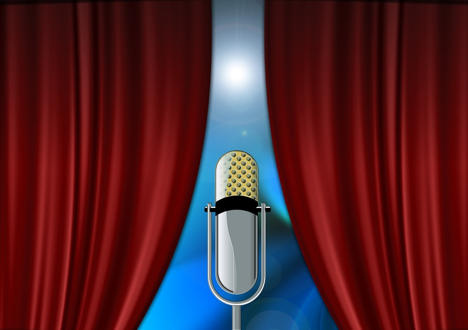 Microphone framed by red curtains