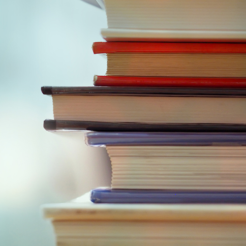 Photo of a stack of 6 books