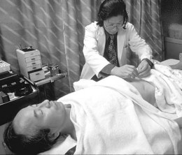 Acupuncture is being performed on a patient