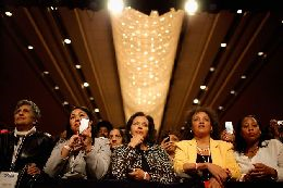 Supporters listen as U.S. President Barack Obama addresses the Women's Leadership Forum