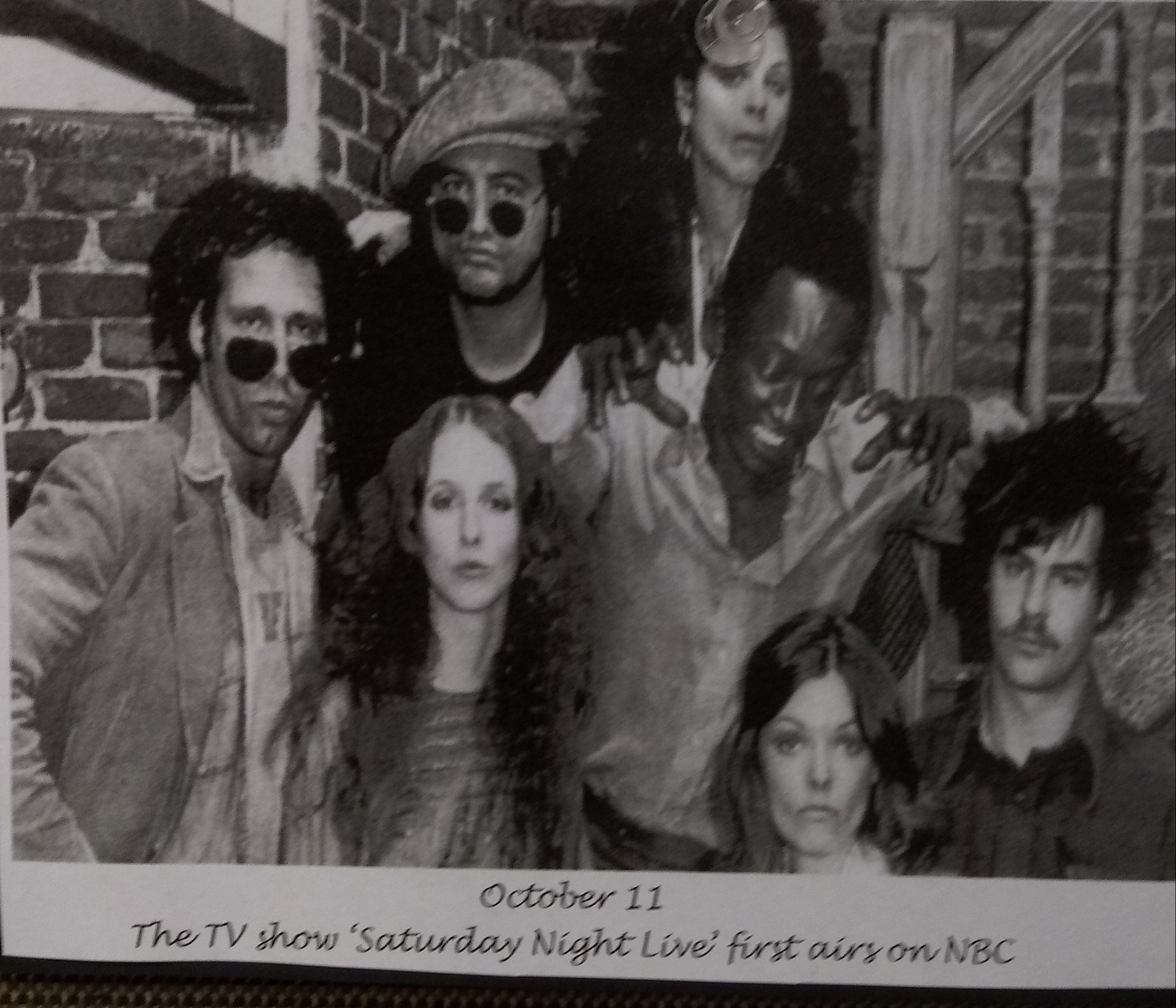 Photograph of a group of actors from the 1st season of the Saturday Night Live show.