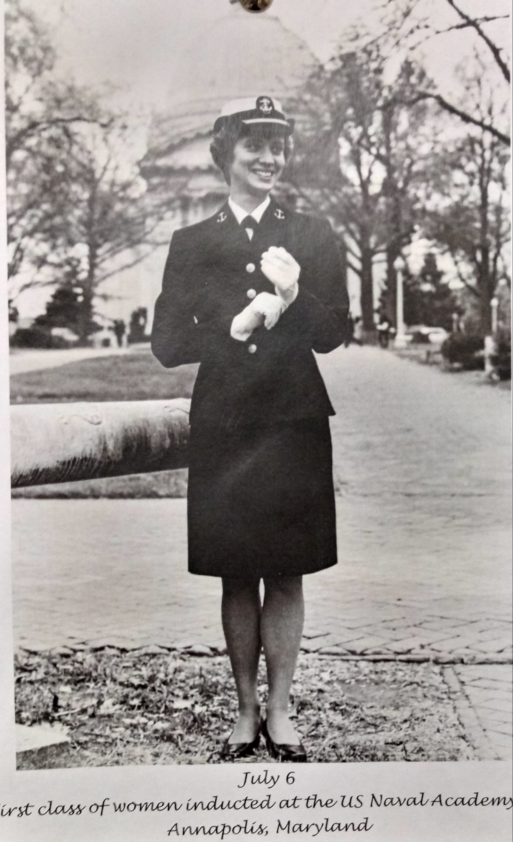 Photograph of a female Naval Academcy inductee in her uniform.