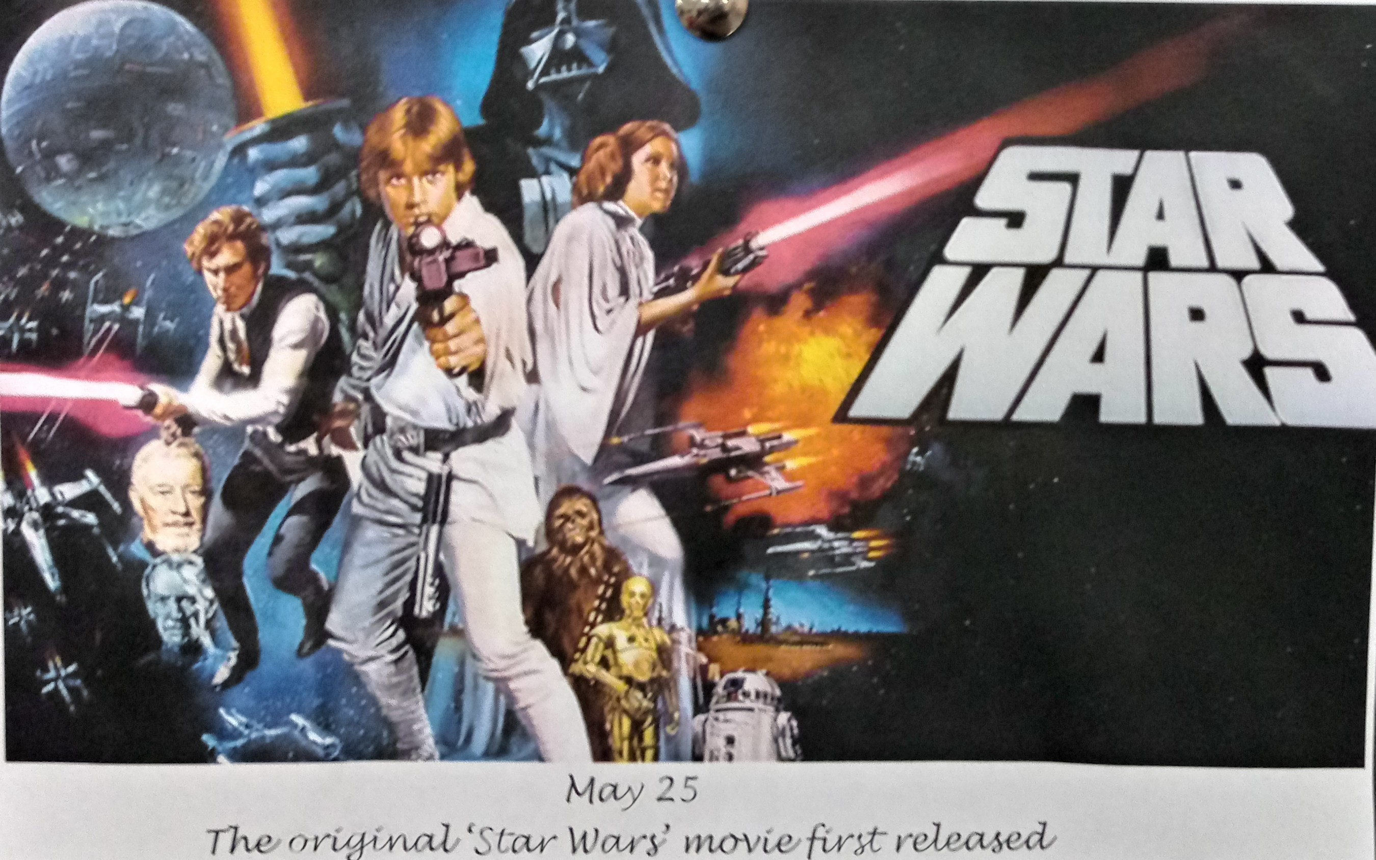 Reproduction of the original Star Wars movie ad featuring the main characters of the movie