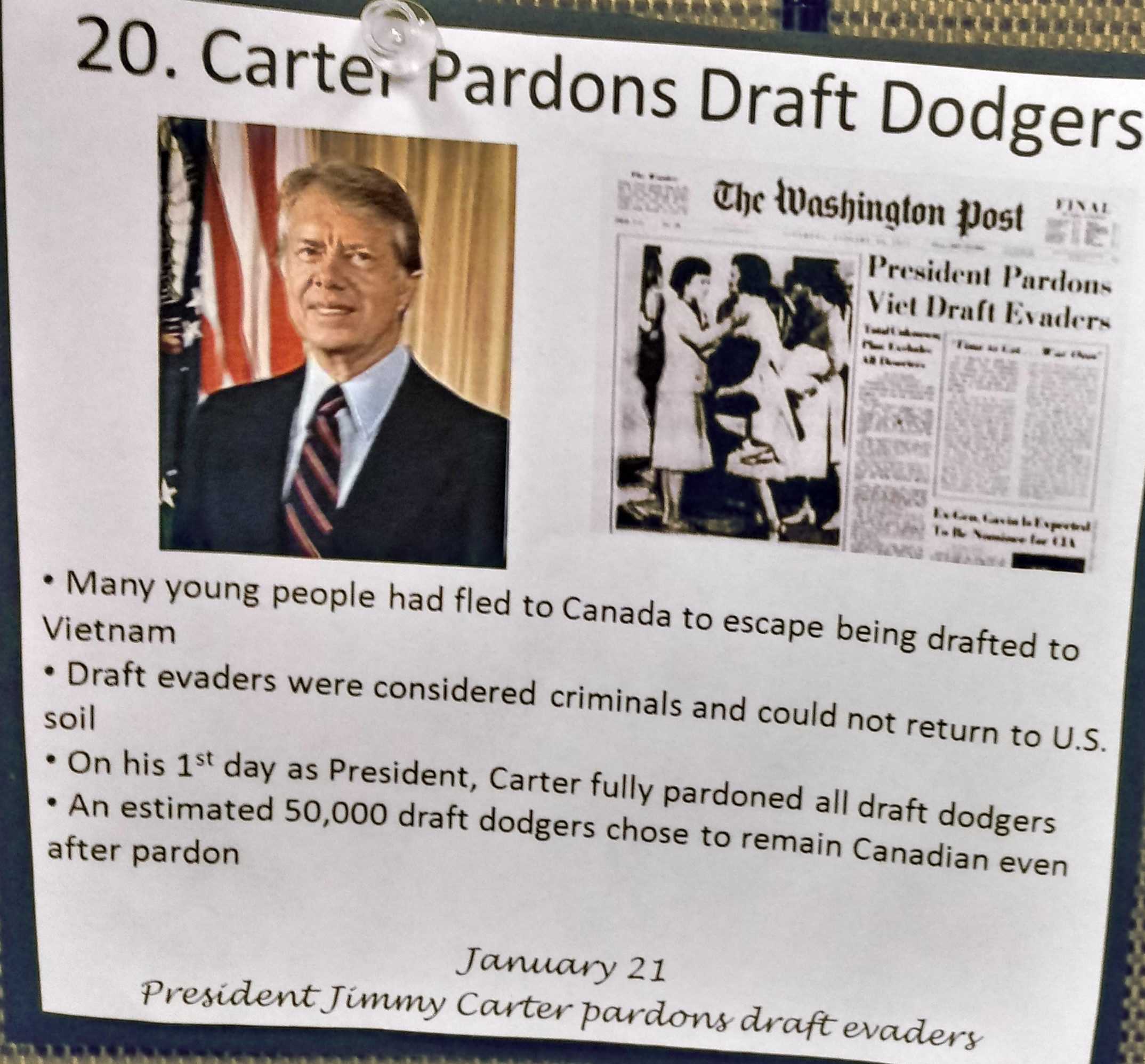 """Photograph of President Carter & reproduction of p.1 of the Washington Post, banner headline, """"President Pardons Viet Draft Evaders."""""""